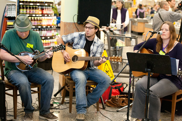 a group performing music at a new seasons store opening