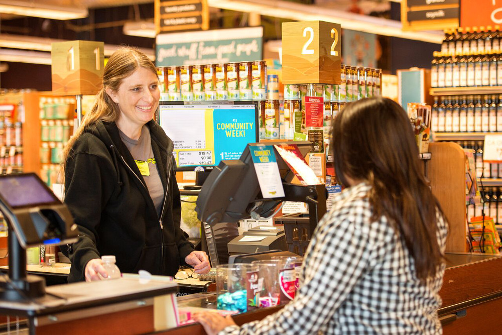 an employee ringing up a member of the community