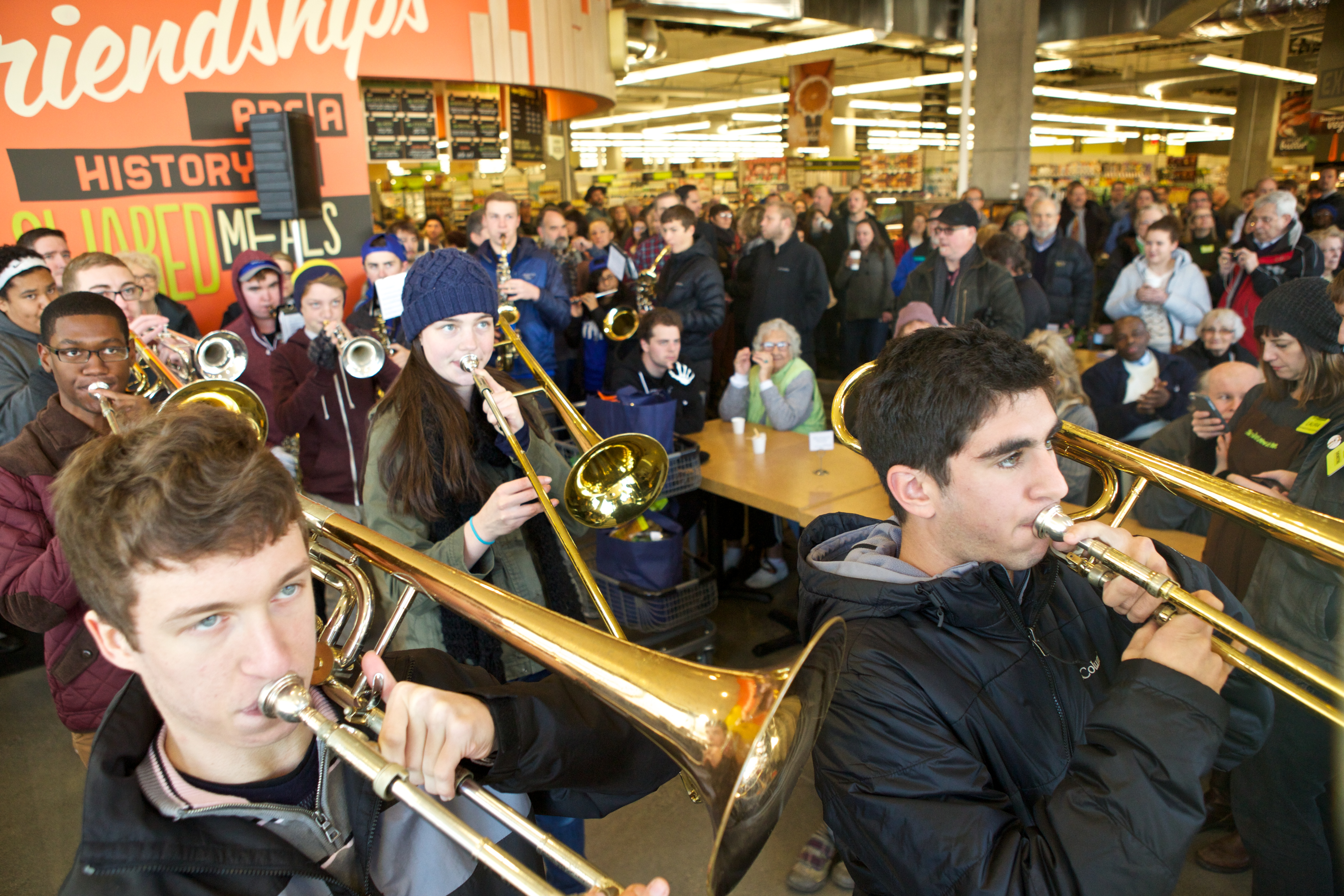 a marching band inside a new seasons market