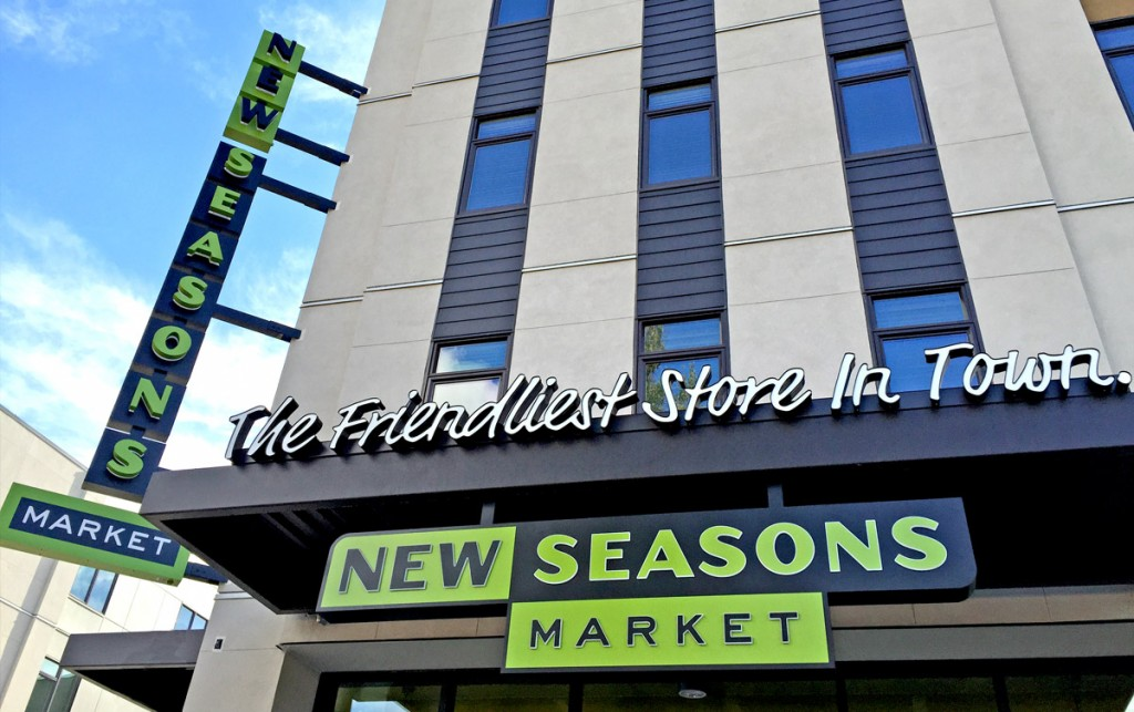 new seasons market store sign reading the friendliest store in town