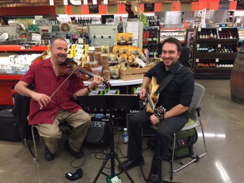 a musical duo performing in a new seasons store
