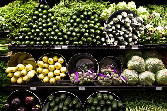 new seasons produce shelves featuring zucchinis squash cabbage eggplant and green beans