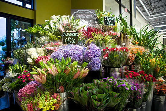 a cascading wall of colorful blooms in the floral department