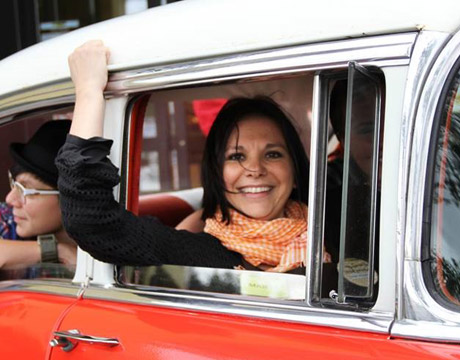 marta majewska in the window of a vintage car