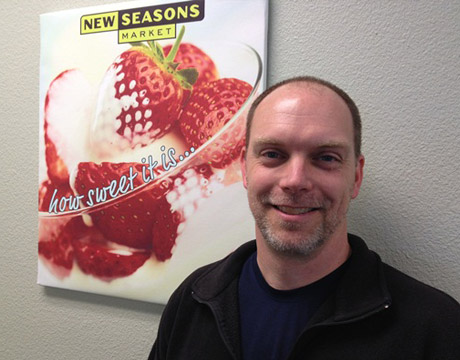 scott weseman in front of a poster of strawberries in cream