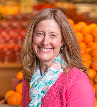 woman in store smiling at the camera