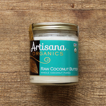 a jar of artisana brand raw coconut butter