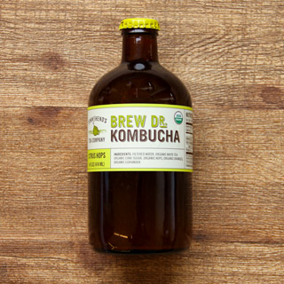 a bottle of townshends brand brew doctor kombucha in citrus hops