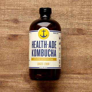 a bottle of health ade brand kombucha in ginger lemon