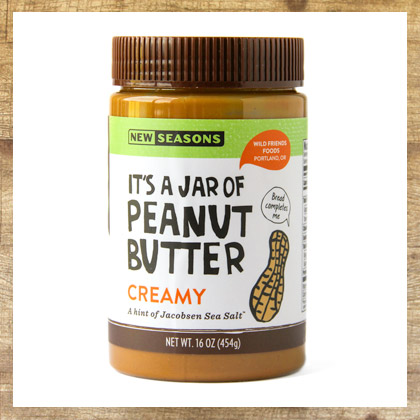 a jar of new seasons brand creamy peanut butter