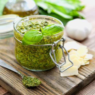 Asparagus pesto in a glass jar with cheese on the side