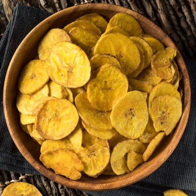 Wooden bowl of plantain chips