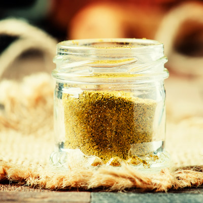 Glass jar of curry spices