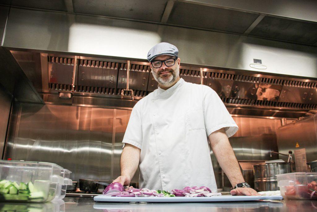 chef in kitchen preparing fresh vegetables