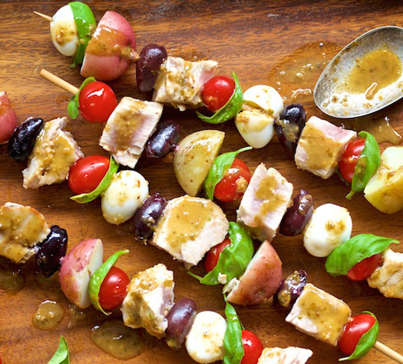 four tuna skewers with vegetables and glaze
