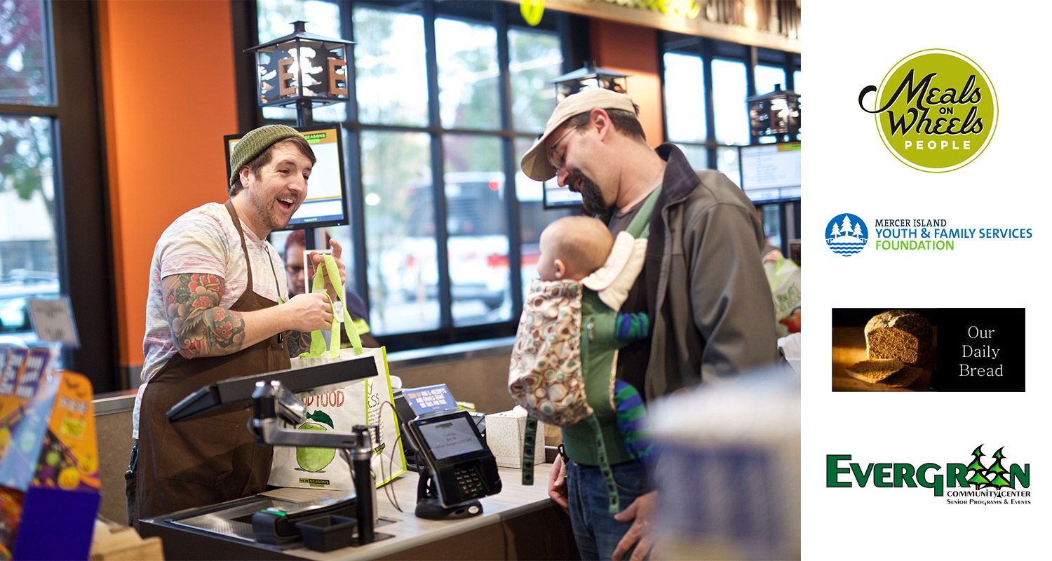 Cashier handing bag to man with little baby