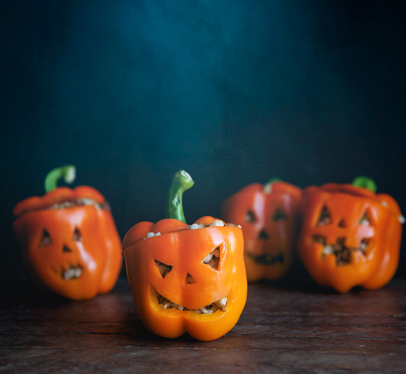 Orange bell peppers with jack-o-lantern faces