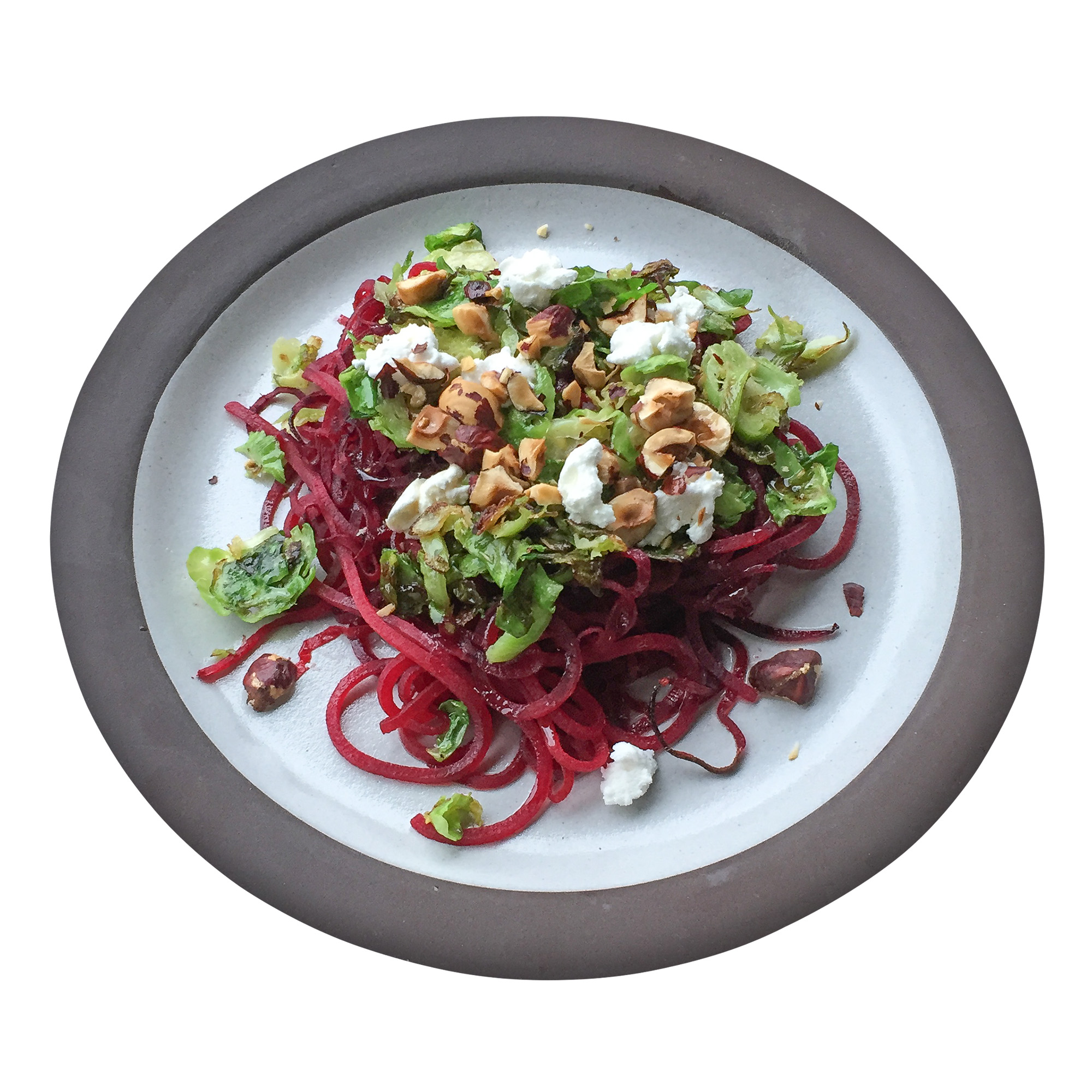 Plate of spiraled beets and salad toppings